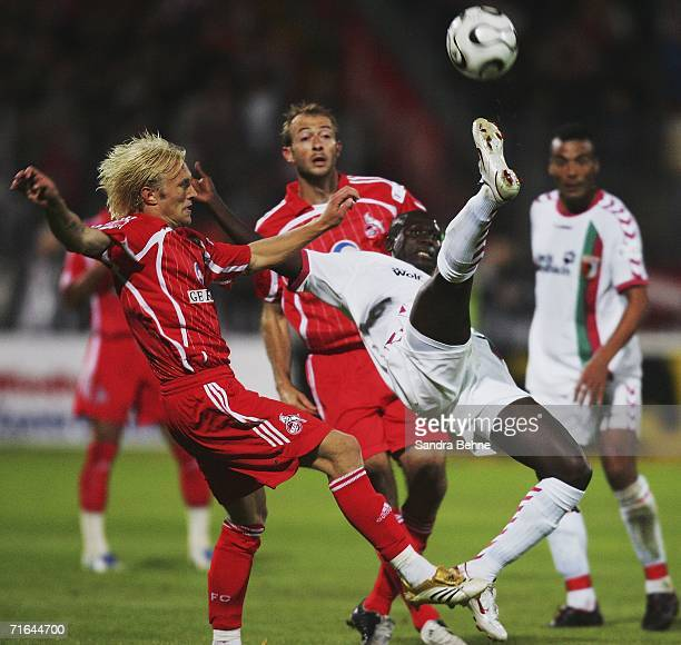 Momo Diabang of Augsburg challenges Pekka Lagerblom of Cologne during the Second Bundesliga match between FC Augsburg and 1FC Cologne at the Rosenau...