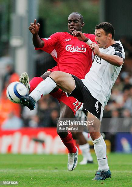 Momo Sissoko of Liverpool challenges Steed Malbranque of Fulham during the Barclays Premiership match between Fulham and Liverpool at Craven Cottage...