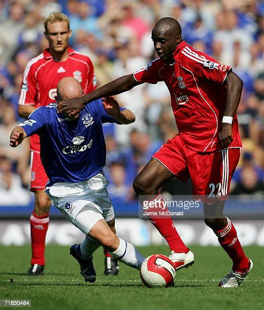 Momo Sissoko of Liverpool holds off the challenge of Lee Carsley of Everton during the Barclays Premiership match between Everton and Liverpool at...