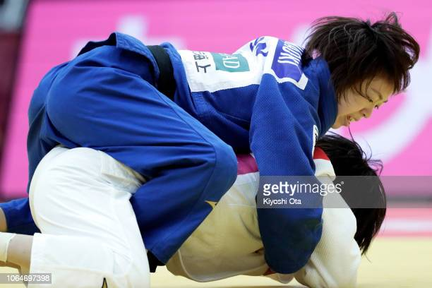 Momo Tamaoki of Japan competes against Tsukasa Yoshida of Japan in the Women's 57kg semifinal match on day two of the Grand Slam Osaka at Maruzen...