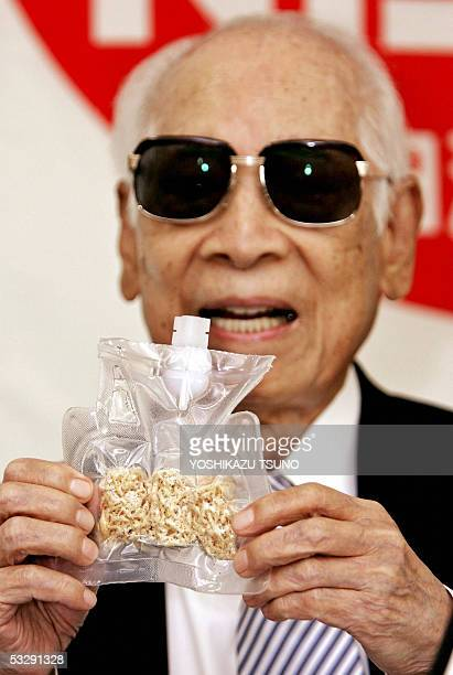 Momofuku Ando Nissin food products chairman and popularly known as maker of instant noodles displays the instant noodles for astronauts called Space...
