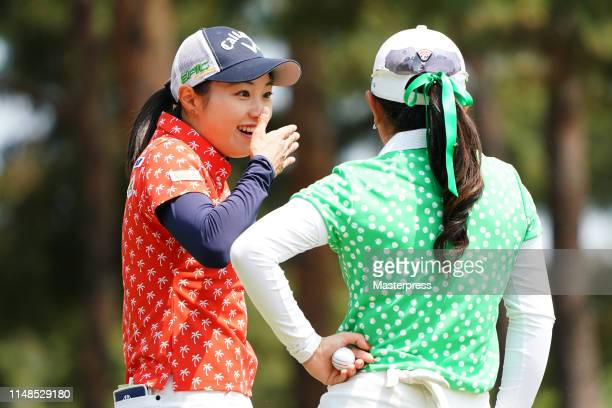 Momoka Miura and Yui Kawamoto of Japan share a laugh on the 7th green during the final round of the World Ladies Championship Salonpas Cup at Ibaraki...