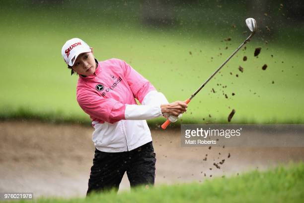 Momoka Miura of Japan hits out of the bunker on the 11th hole during the second round of the Nichirei Ladies at the Sodegaura Country Club Shinsode...