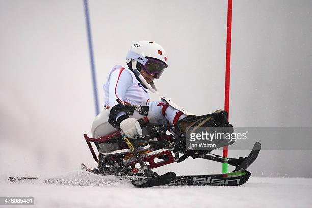 Momoka Muraoka of Japan competes in the Women's Slalom 1st Run Sitting during day five of Sochi 2014 Paralympic Winter Games at Rosa Khutor Alpine...