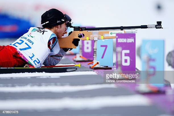 Momoko Dekijima of Japan competes in the Women's 125km Biathlon Standing during day seven of the Sochi 2014 Paralympic Winter Games at Laura...