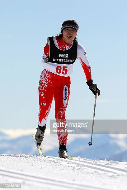 Momoko Dekijima of Japan competes in the Women's Standing 10km Individual Cross Country during day one of the Winter Games NZ at Snow Farm on August...