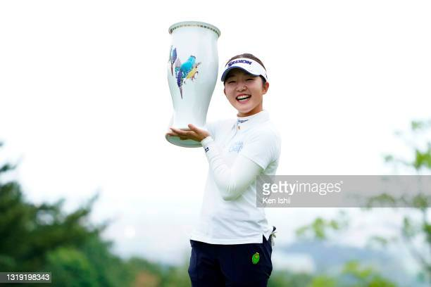 Momoko Kishibe of Japan poses with the trophy after winning the tournament following the final round of the Twin Fields Ladies at the Golf Club Twin...