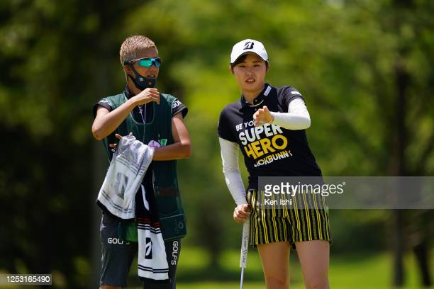 Momoko Osato of Japan discusses with her caddie on the 5th green during the final round of the Earth Mondamin Cup at the Camellia Hills Country Club...
