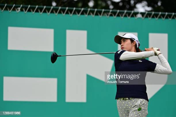Momoko Osato of Japan hits her tee shot on the 14th hole during the third round of the Nitori Ladies Golf Tournament at the Otaru Country Club on...