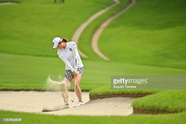 Momoko Osato of Japan hits out from a bunker on the 17th hole during the third round of the Earth Mondamin Cup at the Camellia Hills Country Club on...