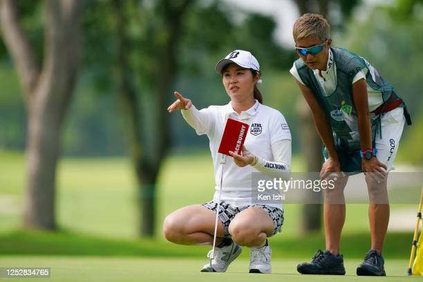 Momoko Osato of Japan lines up a putt on the 18th green during the third round of the Earth Mondamin Cup at the Camellia Hills Country Club on June...