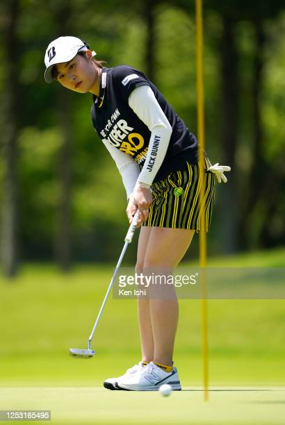 Momoko Osato of Japan lines up a putt on the 5th green during the final round of the Earth Mondamin Cup at the Camellia Hills Country Club on June 29...