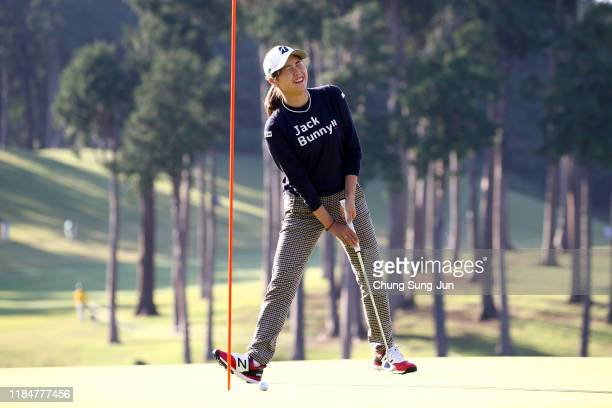 Momoko Osato of Japan reacts after a putt on the 18th green during the first round of the Hisako Higuchi Mitsubishi Electric Ladies at Musashigaoka...