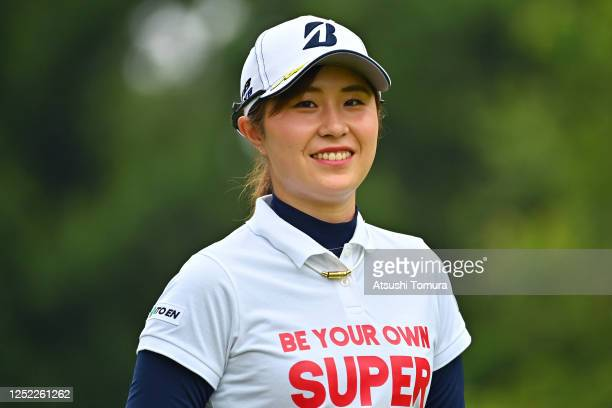 Momoko Osato of Japan smiles after her tee shot on the 11th hole during the first round of the Earth Mondamin Cup at the Camellia Hills Country Club...