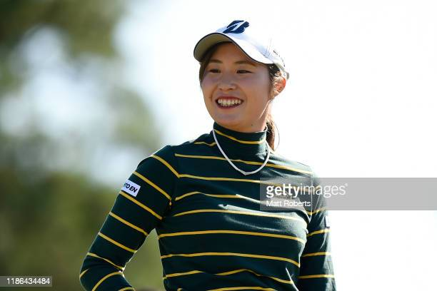 Momoko Osato of Japan smiles her tee shot on the 14th hole during the second round of the TOTO Japan Classic at Seta Golf Course North Course on...