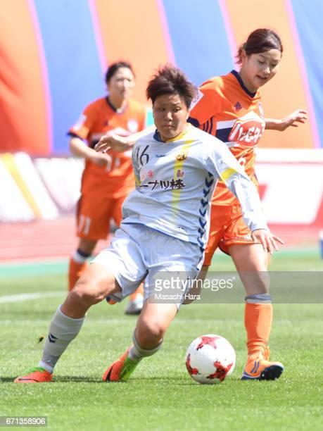 Momoko Sayama of Albirex Nigata and Ayaka Michigami of INAC Kobe Leonessa compete for the ball during the Nadeshiko League match between Albirex...