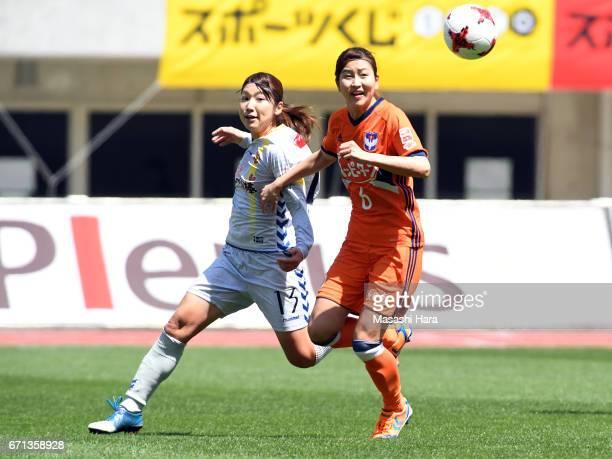 Momoko Sayama of Albirex Nigata and Ayu Nakada of INAC Kobe Leonessa compete for the ball during the Nadeshiko League match between Albirex Niigata...
