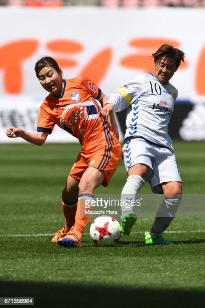 Momoko Sayama of Albirex Nigata and Shinobu Ohno of INAC Kobe Leonessa compete for the ball during the Nadeshiko League match between Albirex Niigata...