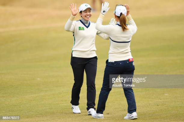 Momoko Ueda and Yukari Nishiyama of Japan celebrate after their second shots during the first round of the Queens at Miyoshi Country Club on December...