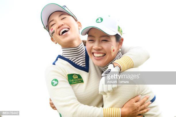Momoko Ueda and Yukari Nishiyama of Japan celebrate after winning their match during the first round of the Queens at Miyoshi Country Club on...
