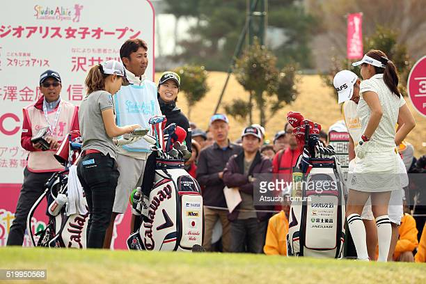 Momoko Ueda Asuka Kashiwabara and Hikari Fujita of Japan prepare to play on the 1st tee ground during the second round of the Studio Alice Open at...