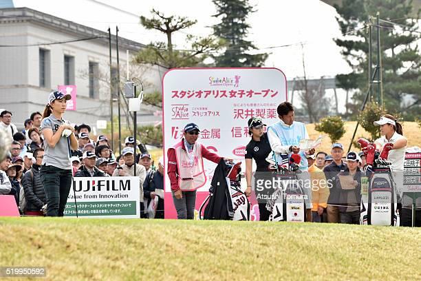 Momoko Ueda Asuka Kashiwabara and Hikari Fujita of Japan prepare to play on the 1st tee ground during the second round of the Studio Alice Open at...