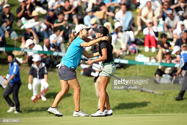 Momoko Ueda of Japan and P Chutichai of Thailand hug during the final round of the Yonex Ladies Golf Tournament 2016 at the Yonex Country Club on...