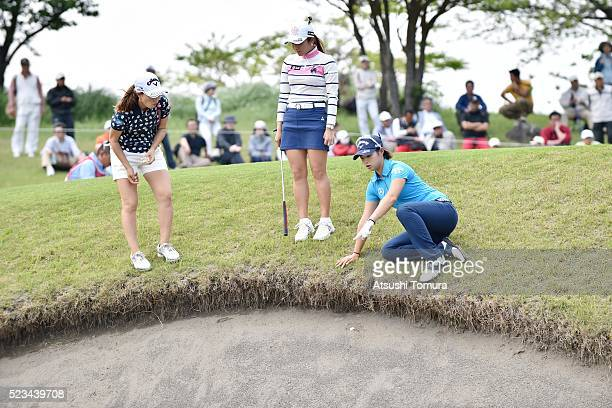 Momoko Ueda of Japan BoMee Lee of South Korea and Asuka Kashiwabara of Japan checking the ball on the bunker on the 11th hole during the second round...