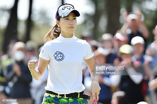 Momoko Ueda of Japan celebrates after making her birdie putt on the 17th green during the World Ladies Championship Salonpas Cup at the Ibaraki Golf...
