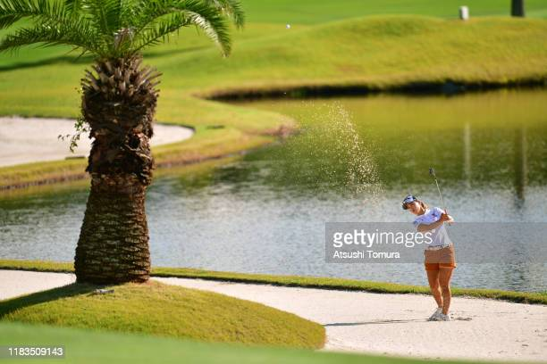 Momoko Ueda of Japan hits out from a bunker on the 15th hole during the third round of the Nobuta Group Masters GC Ladies at Masters Golf Club on...
