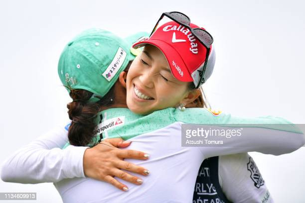 Momoko Ueda of Japan hugs BoMee Lee of South Korea during the third round of the Daikin Orchid Ladies Golf Tournament at Ryukyu Golf Club on March 09...