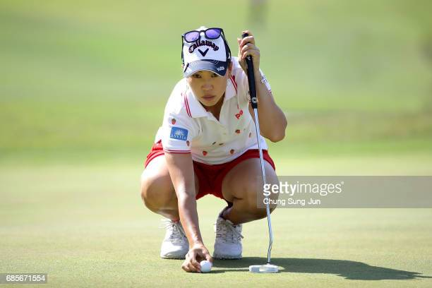 Momoko Ueda of Japan looks over a green on the 18th green of second round during the Chukyo Television Bridgestone Ladies Open at the Chukyo Golf...