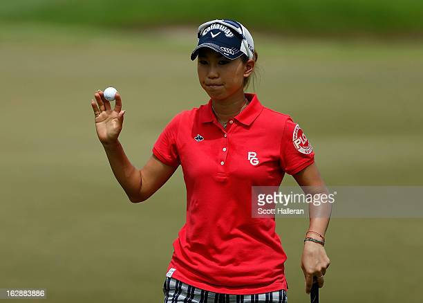 Momoko Ueda of Japan makes birdie on the 15th hole during the second round of the HSBC Women's Champions at the Sentosa Golf Club on March 1 2013 in...