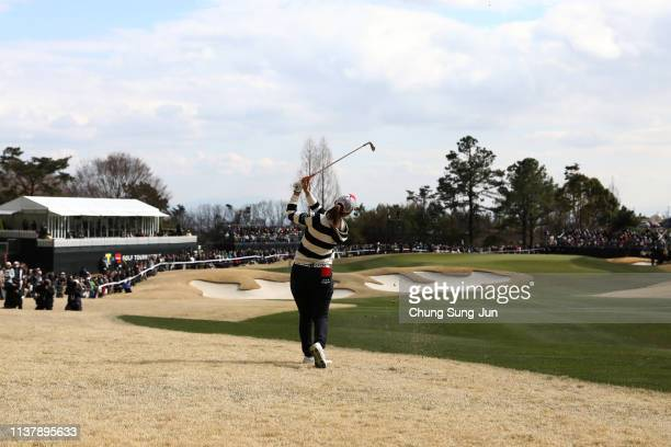 Momoko Ueda of Japan plays a second shot on the 18th hole during the final round of the TPoint x ENEOS Golf Tournament at Ibaraki Kokusai Golf Club...