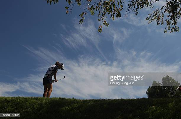 Momoko Ueda of Japan plays a shot on the 14th hole during the final round of the 48th LPGA Championship Konica Minolta Cup 2015 at the Passage Kinkai...