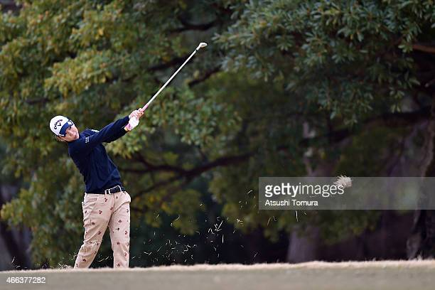 Momoko Ueda of Japan plays her shot on the first hole during the final round of the Yokohama Tyre PRGR Ladies Cup at the Tosa Country Club on March...