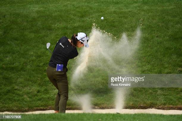 Momoko Ueda of Japan plays her third shot from a bunker on the 18th hole during Day Two of the AIG Women's British Open at Woburn Golf Club on August...