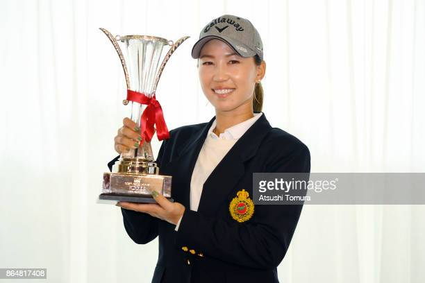 Momoko Ueda of Japan poses with the trophy after winning the Nobuta Group Masters GC Ladies at the Masters Golf Club on October 22 2017 in Miki Hyogo...