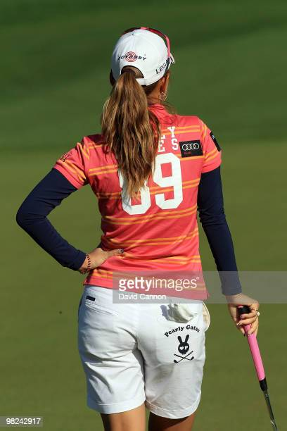 Momoko Ueda of Japan putting on the second hole during the final round of the 2010 Kraft Nabisco Championship on the Dinah Shore Course at The...