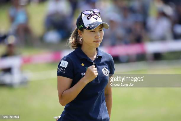 Momoko Ueda of Japan reacts after birdie putt on the 14th green during the final round of the Chukyo Television Bridgestone Ladies Open at the Chukyo...