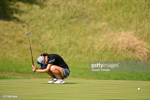 Momoko Ueda of Japan shows dejection after missing the birdie putt on the 8th green during the second round of the Japan Women's Open Golf...