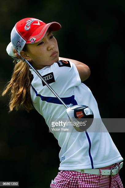 Momoko Ueda of Japan tees off on the 9th hole during round two of the Honda LPGA Thailand at the Siam Country Club on February 19 2010 in Chon Buri...