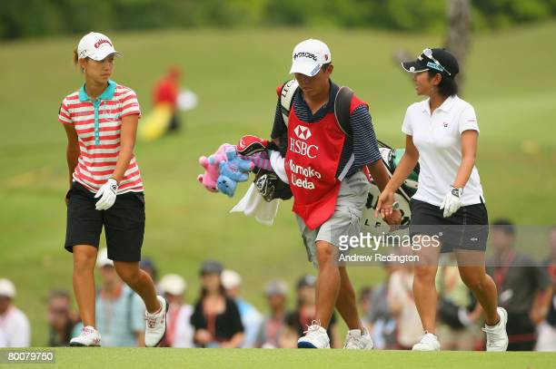 Momoko Ueda of Japan walks with Ai Miyazato of Japan on the ninth hole during the final round of the HSBC Women's Champions at Tanah Merah Country...