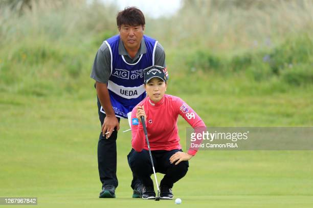 MomokoUeda of Japan and her caddie Haruyuki Tsujimura line up a putt on the 6th hole during Day Four of the 2020 AIG Women's Open at Royal Troon on...