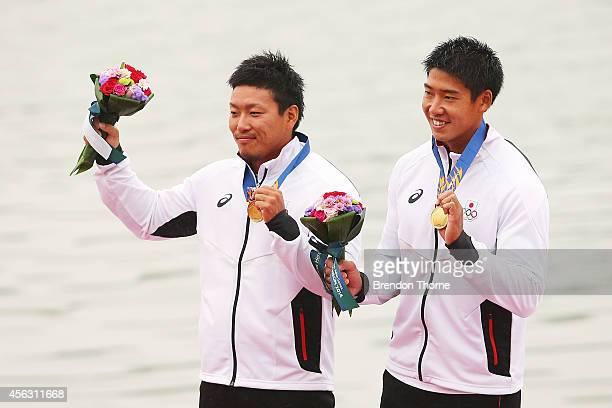 Momotaro Matsushita and Hiroki Fujishima of Japan celebrate atop the podium following the Men's K2 200m Final during day ten of the 2014 Asian Games...