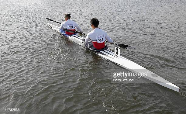 Momotaro Matsushita and Hiroki Watanabe of Japan canoe out to the men's kayak double 500m heat during day one of the ICF Canoe Sprint World Cup 2012...