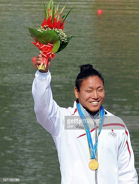 Momotaro Matsushita of Japan celebrates on the podium during the medals ceremony for the men's 200m kayak final at the 16th Asian Games in Guangzhou...