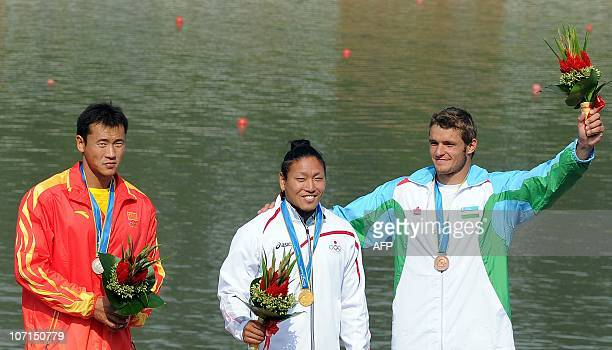 Momotaro Matsushita of Japan Zhou Peng of China and Alexey Mochalov of Uzbekistan celebrate on the podium during the medals ceremony for the men's...