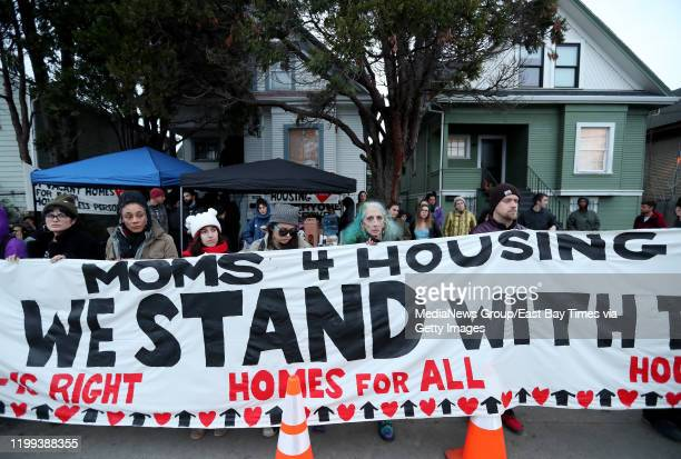 Moms 4 Housing supporters protest in front of a vacant house in West Oakland Calif on Monday January 13 2020 Members of the group have been illegally...