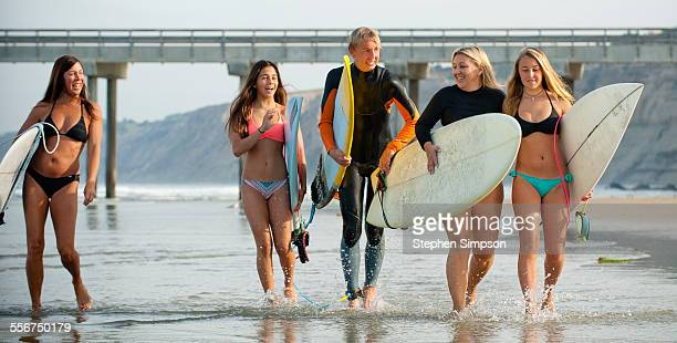 Moms and children going surfing